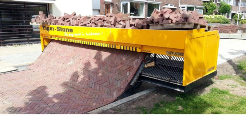 Robot that is helping pavers lay pavers more efficiently