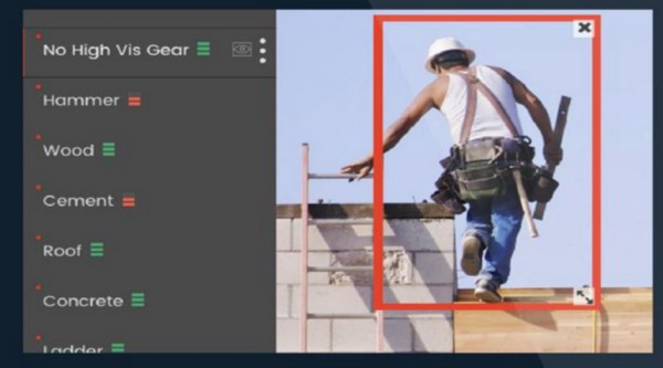 In this image of a construction worker stepping off a ladder, Smartvid.io can automatically add the tags shown on the left to the image.